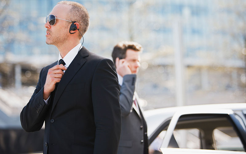 An image of men providing client protection services